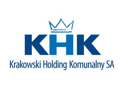 Logo Krakowski Holding Komunalny. Drukowane litery KHK w środku. Poniżej pełna nazwa. U góry korona.